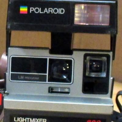 Open Plaats - retro polaroid fototoestel in de kringloopwinkel