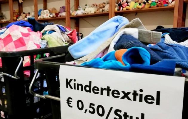 Open Plaats tweedehands kinderkleding en ander textiel in de kringloopwinkel