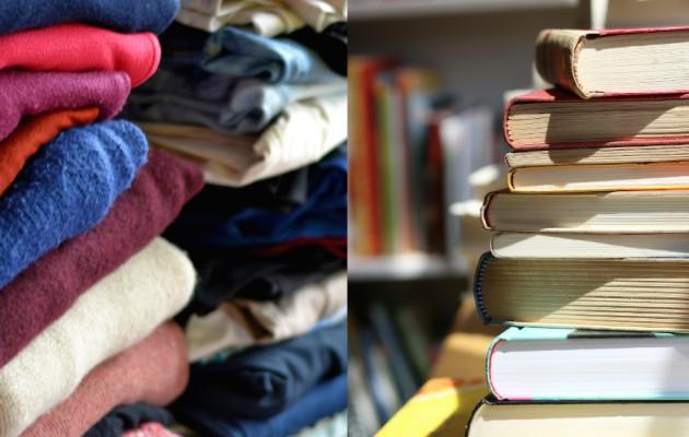 Open Plaats stapels kleren en boeken op de stockverkoop in de kringloopwinkel in Gent - Brugse Poort